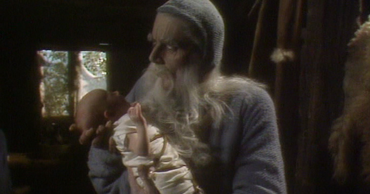 Merlin (Robert Eddison) cradles baby King Arthur (my sister)